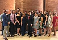 Dan Boren poses for a pic with PLC students after serving as the keynote speaker at the annual PLC Banquet.