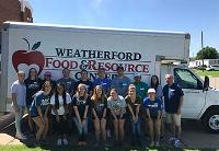 PLC students get involved locally by volunteering at the Weatherford Food and Resource Center.