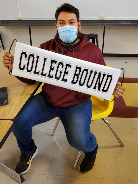 Gear Up Student with College Bound Banner